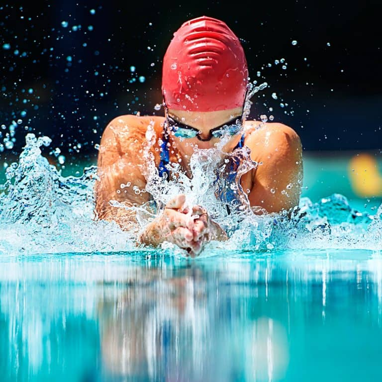 Professional Swimmer in red cap and glasses
