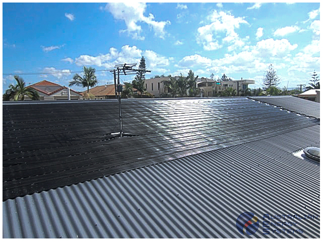Rooftop covered with black solar pool heating