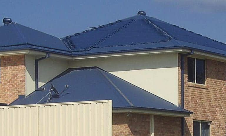 Roof covered with blue solar pool heating panels