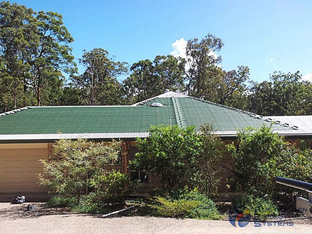 Roof of a cottage covered with Green Solar Pool Heating