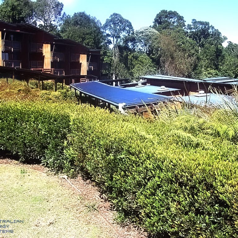 View of Row house with blue solar pool heating