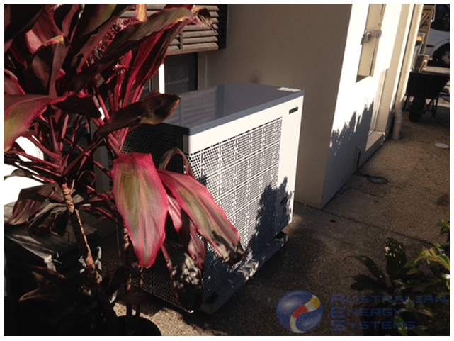 Full Inverter heat pump installed in the backyard of the house