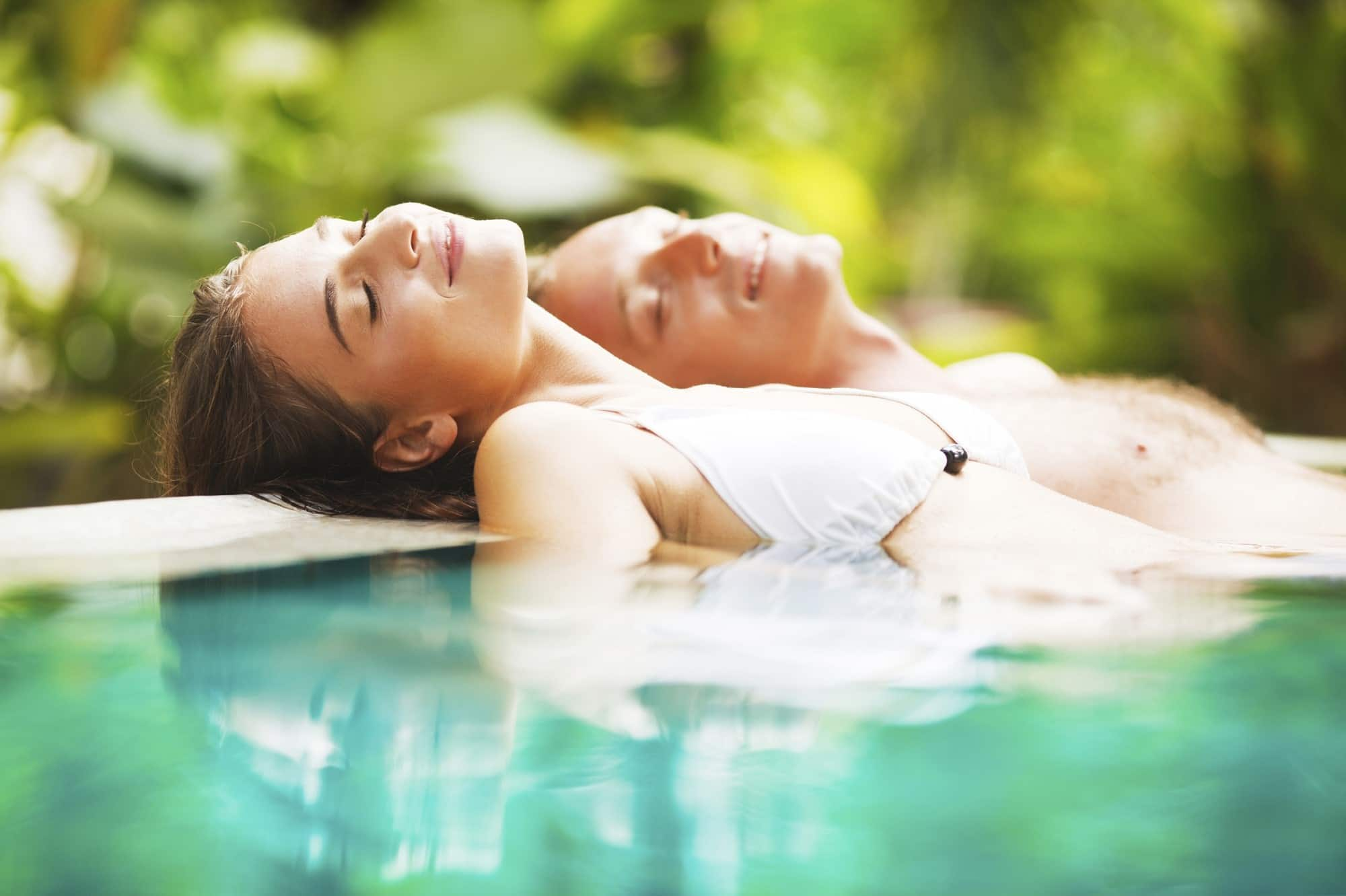 Happy Couple relaxing in Pool