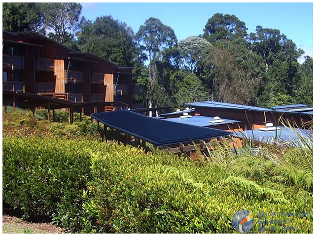 View of Row house with black solar pool heating
